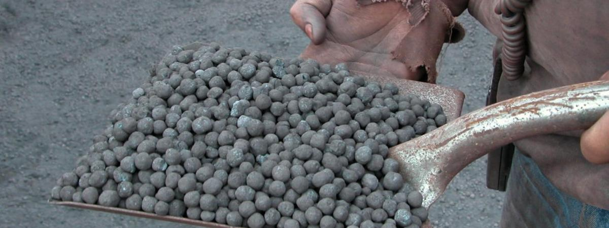 Hand shovel full of taconite pellets