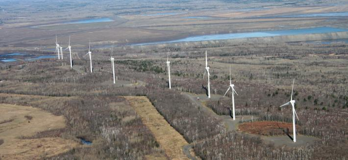Arial view of mining region with a line of six wind generators.