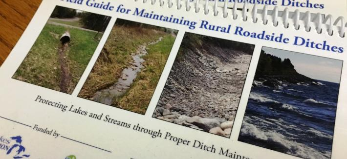 Two spiral bound ditch manuals, one over other to show cover