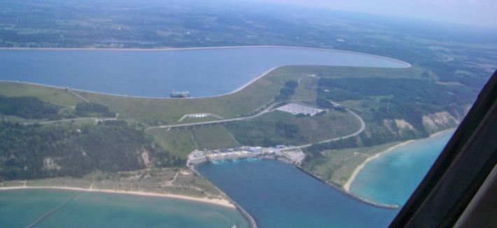 Arial view of a pumped hydro facility, one pond at a higher elevation and a second pond.