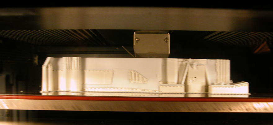 A part being made in the Fused Deposition Modeling prototype machine