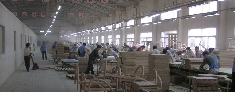 People working in a wood products factory in China.