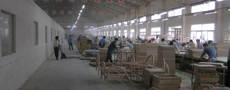 Manufacturing wood products in China, many people working at machines