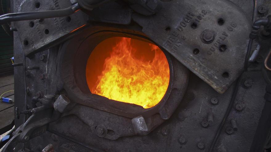 Fire flames seen through open furnace doors