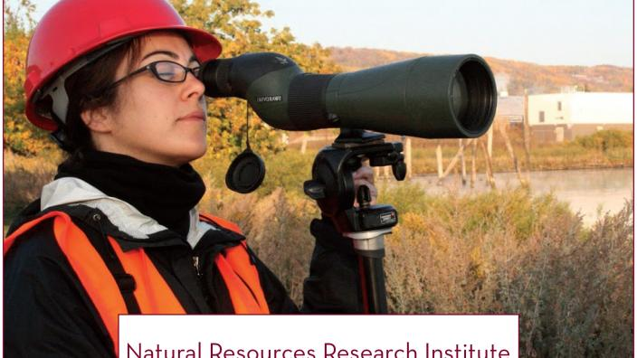 Top portion of Annual Report cover featuring a woman outdoors looking through a scope.
