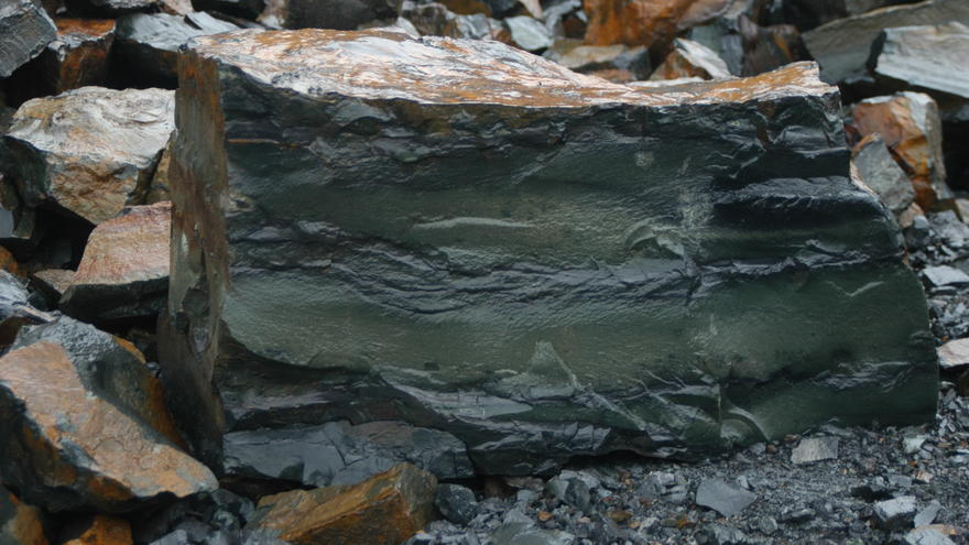 Close up image of grey rock to show layered stripping