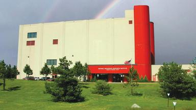 NRRI building, front view with rainbow above