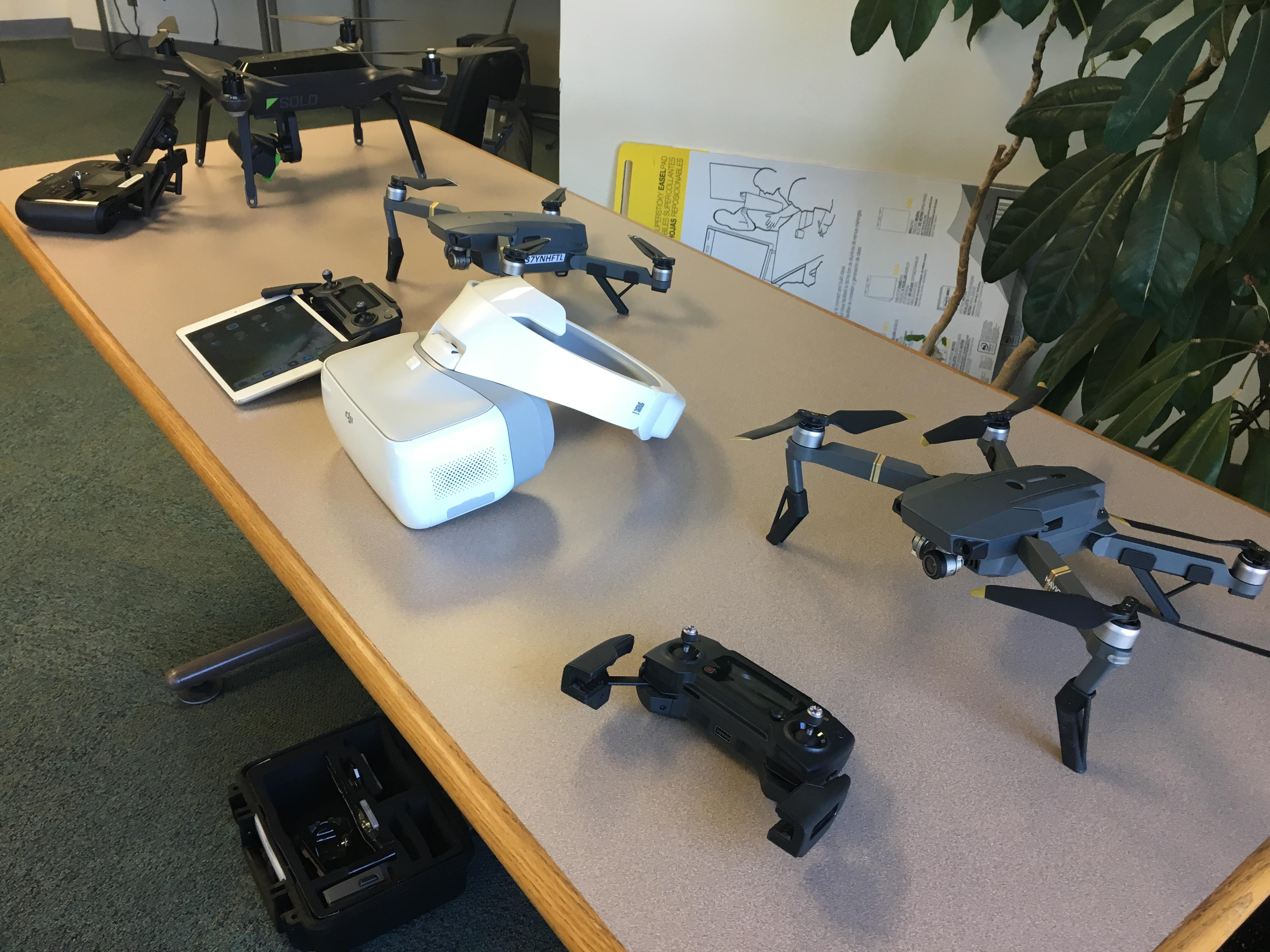 Table top display of five different drone technologies.